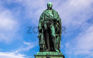 Details of Monument of Karl Friedrich von Baden with blue sky in background. Near Castle Karlsruhe, Baden-Wuerttemberg, Germany