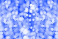 Blue bokeh. Unobtrusive abstract background. Flickering lights. Defocused blurred.