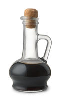 Side view of soy sauce in glass bottle