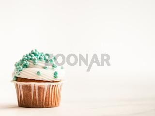 Cupcake decorated blue sprinkles, copy space