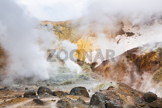 Volcanic landscape, crater of active volcano: hot spring, fumarole, lava field, gas-steam activity. Dramatic mountain landscape, travel destinations