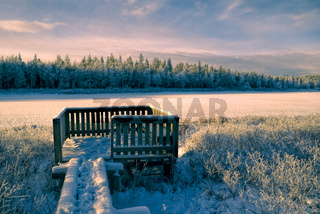 Breathtaking view of a winter forest and a wooden viewpoint