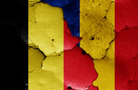 flags of Belgium and Romania painted on cracked wall