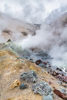 Mountain landscape, crater of active volcano: fumarole, hot spring, lava field, gas-steam activity