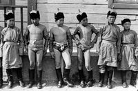 Young Mongolian wrestlers before a competition in traditional Mongolian Eagle Wrestling, photo 1977