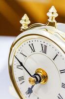 Closeup of table period clock with oscillating mec