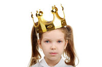 A little girl wears a crown