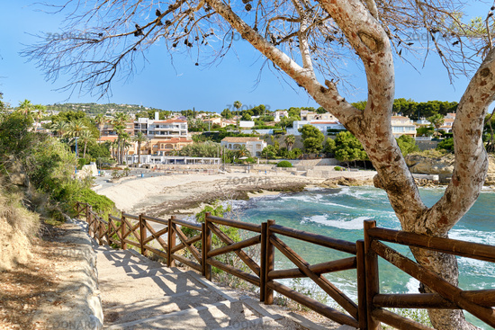 Pathway fenced with wooden railings lead to Benisa beach. Costa Blanca, Spain