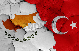 flags of Cyprus and Turkey painted on cracked wall