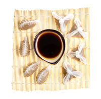 top view of various Dim sum on mat isolated