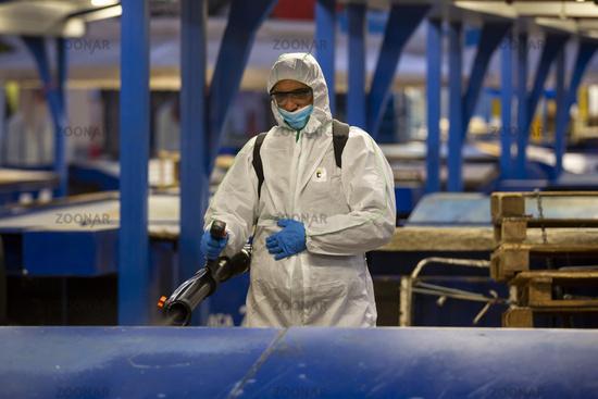 Worker spray disinfectant COVID-19 coronavirus