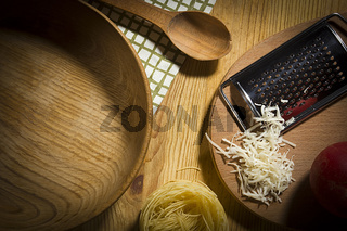 Wooden utensils with ingredients for making pasta