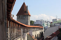 Old town wall of Tallinn with roofed guard's walkway and Hellemann tower