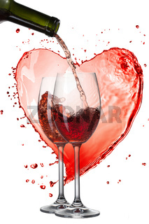 Red wine pouring into glasses with splash against heart isolated on white