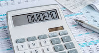 A calculator with the word Dividend on the display