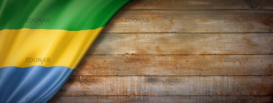 Gabonese flag on vintage wood wall banner