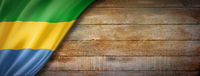 Gabonese flag on vintage wood wall banner