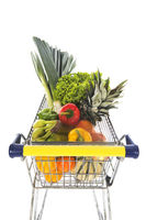 Shopping cart full with fruit and vegetables