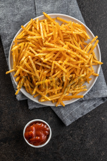 French fries. Fried mini potato sticks and ketchup