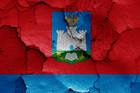 flag of Oryol Oblast painted on cracked wall