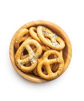 Crispy salted pretzels in wooden bowl