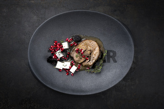 Gravy Greek lamb roast with feta cheese and fruits as minimalistic gourmet meal as top view in a modern design plate with copy space