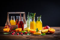 Assortment of juices and lemonades with fruits and herbs on wooden table