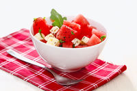 Tasty salad with watermelon on table