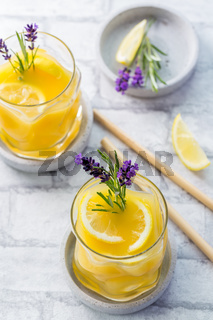 Summer orange and lemon cocktail with fresh lavender and rosemary. Summer lemonade with herbs.
