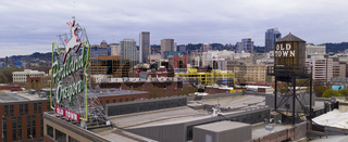 Portland, OR/USA – April 2, 2020: Aerial View over Old Town Porland and the famous neon sign and water tower April 2, 2020