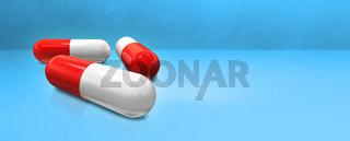 Capsule pill on a blue studio banner
