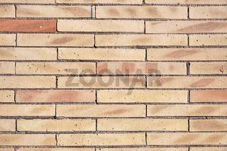 Wand aus beigefarbenen Klinkersteinen