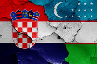 flags of Croatia and Uzbekistan painted on cracked wall