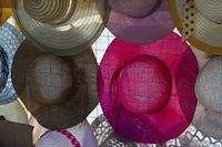 Fashionable Hats on a Street Market in the Port of Puerto Galera on Mindoro Island