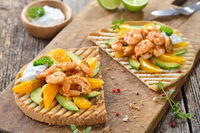 Large fruity toast with shrimps and orange