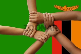 zambia flag, intergration of a multicultural group of young people