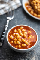 Baked beans in bowl. Beans with tomato sauce