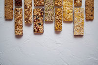 Row of mixed gluten free granola cereal energy bars. With dried fruits and nuts.