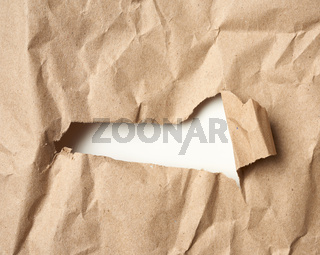 brown kraft paper with hole, edge curled, full frame
