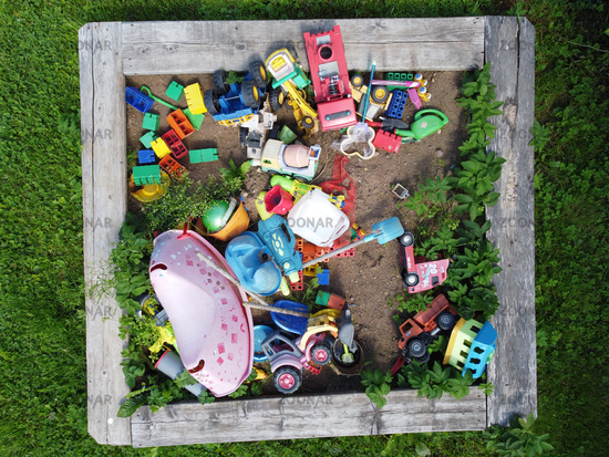 children's toys in the sandbox. Top view