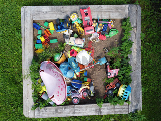 children's toys in the sandbox. Top view