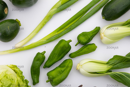 Lettuce, peppers and spring onion on white background
