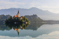 Beautiful reflection of the Bled island and castle in the lake Bled