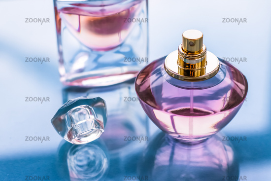 Pink perfume bottle on glossy background, sweet floral scent, glamour fragrance and eau de parfum as holiday gift and luxury beauty cosmetics brand design