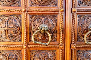 Wooden door with door knob made of bronze