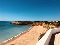 Rocha beach in Portugal, framed by the rocks of the Algarve coast