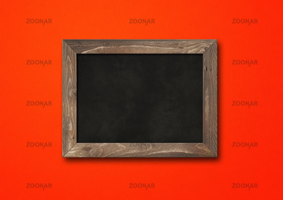 Old rustic black board isolated on a red background
