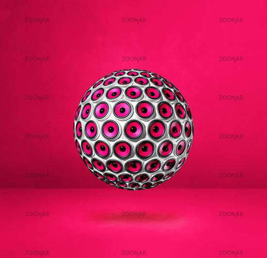 Speakers sphere on a pink studio background