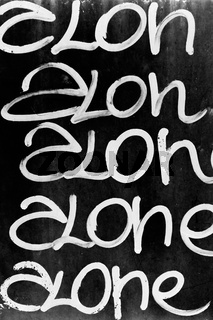 Word 'ALONE' written on black wall