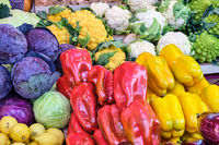 Bell pepper, cabbage and different kinds of broccoli for sale at a market in Rome